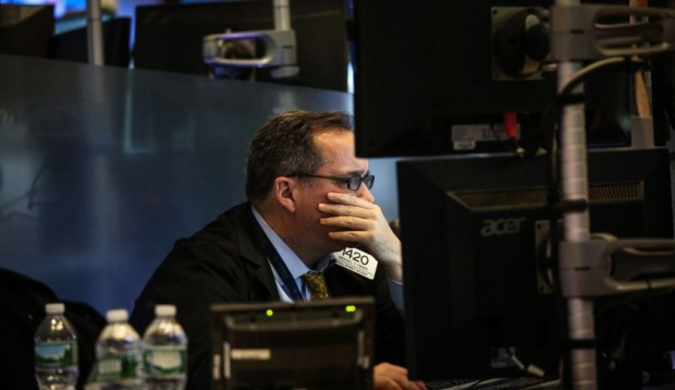 A trader works on the floor of the New York Stock Exchange (NYSE) in New York, U.S., on Friday, Jan. 15, 2016. Stocks tumbled around the world, with U.S. equities headed for their lowest levels since August, and bonds and gold jumped as oil's plunge below $30 sent markets reeling. Treasuries extended gains as economic data and earnings added to concern that global growth is faltering. Photographer: Chris Goodney/Bloomberg via Getty Images